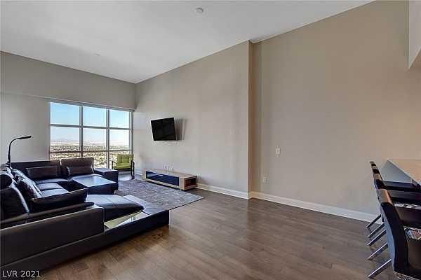 Photo #3 Living room with spectacular windows and balcony a
