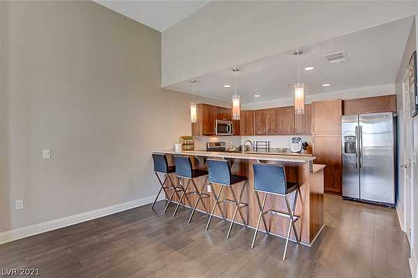 Photo #4 Kitchen to the right with beautiful cabinets and a