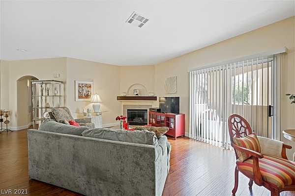 Photo #7 Spacious family room! Natural light and fireplace.