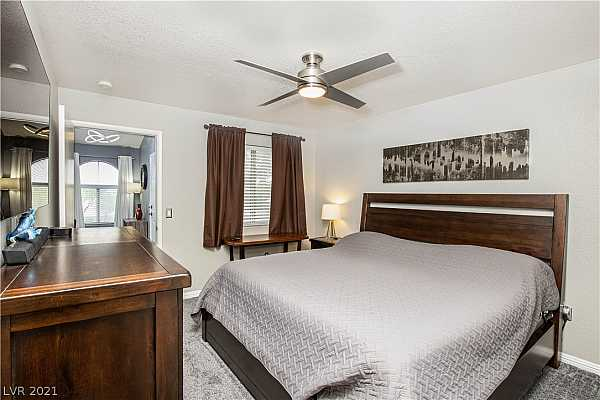 Photo #7 PRIMARY BEDROOM WITH UPDATED CEILING FAN!!!